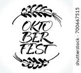 oktoberfest lettering with hand ... | Shutterstock .eps vector #700667515