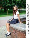 a girl in school uniform on a... | Shutterstock . vector #700684246