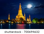 wat arun temple with full moon... | Shutterstock . vector #700694632