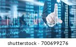 investment concept hand with... | Shutterstock . vector #700699276