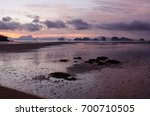 tropical beach with sunrise... | Shutterstock . vector #700710505