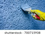 hand in glove with a paint... | Shutterstock . vector #700715938