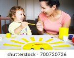the babysitter is drawing with... | Shutterstock . vector #700720726