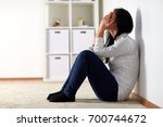 people  grief and domestic... | Shutterstock . vector #700744672