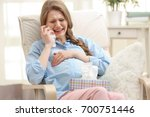 emotional pregnant woman... | Shutterstock . vector #700751446