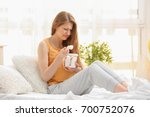 emotional pregnant woman eating ... | Shutterstock . vector #700752076