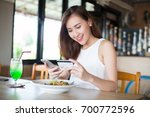 asia woman using credit card...   Shutterstock . vector #700772596