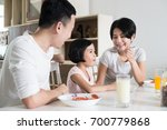 happy asian family enjoying a... | Shutterstock . vector #700779868