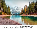 first snow on braies lake.... | Shutterstock . vector #700797046