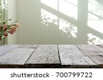 wooden table in front of the... | Shutterstock . vector #700799722