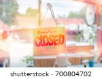 closed sign hanging front of... | Shutterstock . vector #700804702