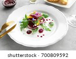 plate with useful beet salad on ... | Shutterstock . vector #700809592