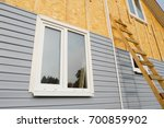 siding covering the wall of a... | Shutterstock . vector #700859902