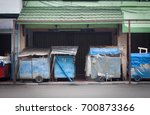 closed store at sidewalk at... | Shutterstock . vector #700873366