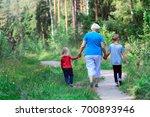 grandmother with kids walk in... | Shutterstock . vector #700893946