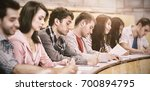 side view of students writing... | Shutterstock . vector #700894795