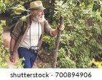 senior male hiker walking with... | Shutterstock . vector #700894906