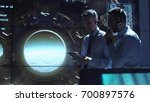two employees control the... | Shutterstock . vector #700897576