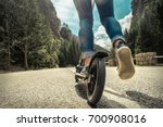 woman on her  kick scooter on... | Shutterstock . vector #700908016