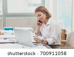 young businesswoman working at...   Shutterstock . vector #700911058