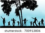 silhouette family playing on... | Shutterstock .eps vector #700913806