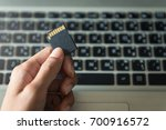 hand holding a camera memory... | Shutterstock . vector #700916572
