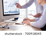 team of traders working with... | Shutterstock . vector #700918045