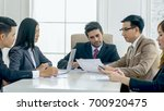 the chief of business team is... | Shutterstock . vector #700920475