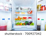 open refrigerator filled with... | Shutterstock . vector #700927342