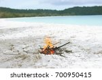 small campfire on the wight... | Shutterstock . vector #700950415