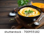 pumpkin cream soup with cream... | Shutterstock . vector #700955182