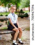 a girl in school uniform on a... | Shutterstock . vector #700967596