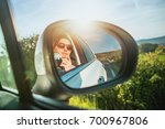 a smiling girl is taking... | Shutterstock . vector #700967806