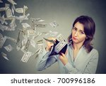 sad woman showing her wallet... | Shutterstock . vector #700996186