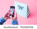 young women taking photo to... | Shutterstock . vector #701002546