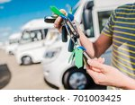 RV Camper Vans and Motorhomes Salesperson with Keys To  Vehicles on the Dealer Lot. - stock photo