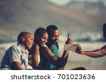 group of happy friends having... | Shutterstock . vector #701023636