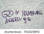 "Small photo of MAGDEBURG, GERMANY – AUGUST 22, 2017: Incitement to violence on a house wall in Magdeburg. Lettering with the words: ""attack G20 in Hamburg""."