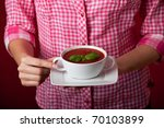 woman holding a tomato soup - stock photo