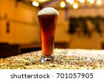 pale ale beer glass in a pub | Shutterstock . vector #701057905
