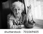 Elderly Woman Talking And...