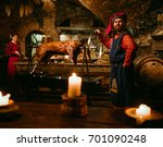 medieval man doing roasted pig... | Shutterstock . vector #701090248