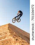 bmx rider performing a look... | Shutterstock . vector #701106472