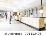 Stock photo abstract blur and defocused lobby in hotel interior for background vintage light filter 701113405