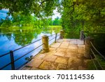 stone pier on the lake. | Shutterstock . vector #701114536