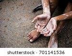 soft focus. hands poor child... | Shutterstock . vector #701141536