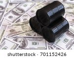 three barrels of oil against...   Shutterstock . vector #701152426
