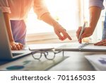 man and woman working in the... | Shutterstock . vector #701165035