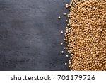 dried chickpeas on dark surface ... | Shutterstock . vector #701179726
