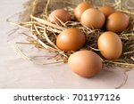 eggs on hay | Shutterstock . vector #701197126